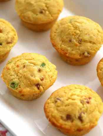 These Ham and Cheese Cornmeal Muffins have little bits of ham, sharp cheddar, and thinly sliced green onions. These cornmeal muffins are the perfect side to a bowl of soup or warmed up for breakfast with a little slab of butter!