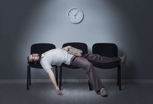 a man asleep in the waiting room
