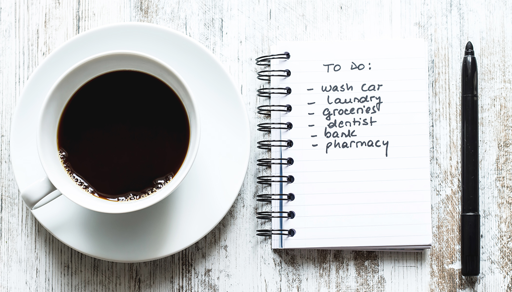 to do list next to cup of coffee