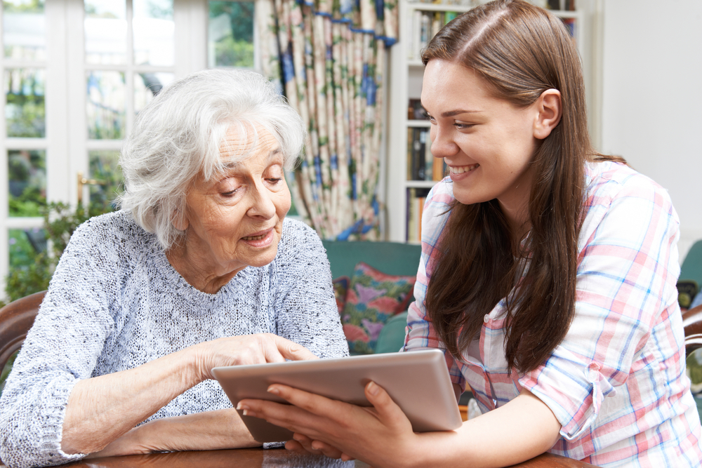 young caregiver with her grandmother and an ipad