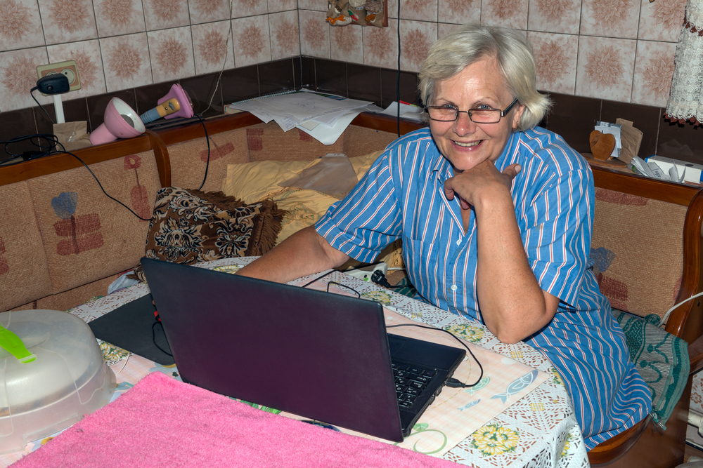 senior woman using the computer at home
