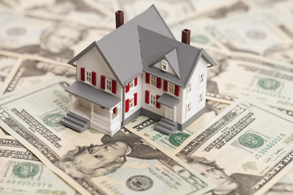 Single family house on pile of money. Concept of real estate, home equity, cost of long-term care