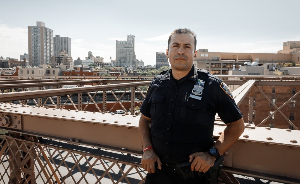 NEW YORK, USA - Sep 22, 2017: Police officer performing his duties on the streets of Manhattan. New York City Police Department (NYPD) is the largest municipal police force in the United States
