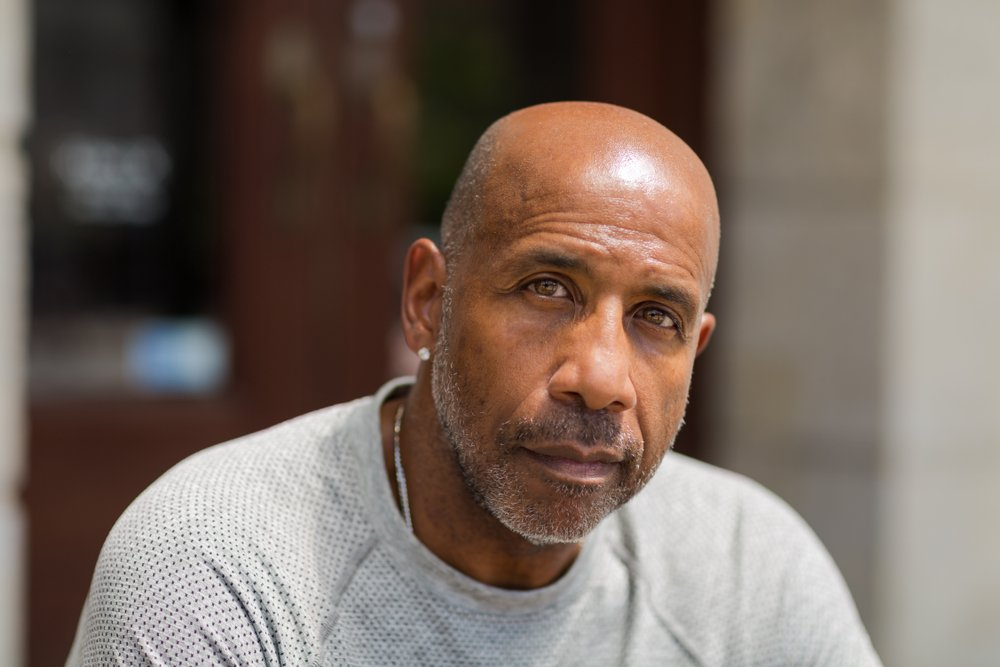 Mature African American man with a concerned look