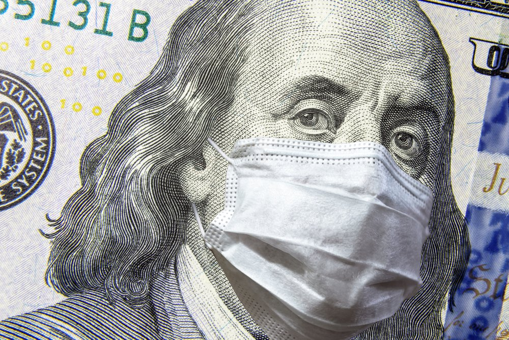 COVID-19 coronavirus in USA, 100 dollar money bill with face mask