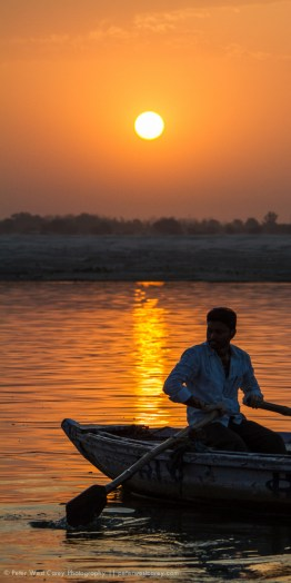 Sunrise and the boatman, Varanasi, India