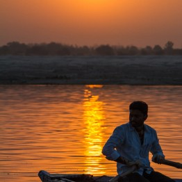 Sunrise and the boatman, Varanasi, India