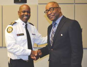 Chief Mark Saunders welcomes Ken Jeffers to the Toronto Police Services Board. Gerald V. Paul photo.