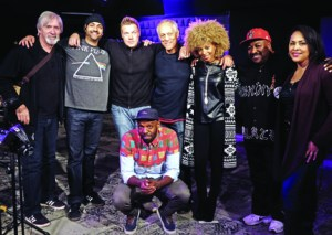 Surrounding Shad on the Q set at CBC, from left, Bill King, Shane 'Shaky J' Forrest, Jesse 'Dubmatix' King, Everton 'Pablo' Paul, Ammoye Evans, Michael Dunston and Selena Evangeline. By Bill King