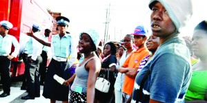 Relatives await news outside Guyana's notorious Camp Street Prison in which rioting claimed 17 lives.
