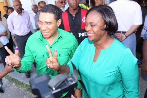 JLP Leader Andrew Holness and wife Juliette celebrate his victory.