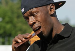 Champion runner Usain Bolt knoshes on chocolate.