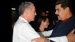 Venezuelan President Nicolas Maduro, right, greets Jamaica President of the Senate Tom Tavares Finson.