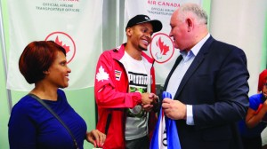 TORONTO, ON - AUGUST, 24    Triple medallist, sprinter  and Markham resident Andre De Grasse is greeted by Markham Mayor Frank Scarpitti and his mom, Beverley. Plane loads of Canadian Olympians returned to Toronto's Pearson International early Wednesday morning from Rio.  August 24, 2016 Richard Lautens/Toronto Star
