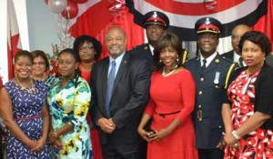 INDEPENDENCE CELEBRATION AT THE TRININDAD AND TOBAGO CONSULATE IN TORONTO: Marcia Annisette (in red) stands next to Kiya P. Clarke , Trinidad and Tobago's acting Consul General ( at right).