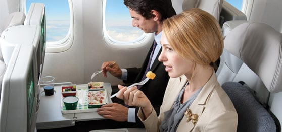 couple eating on an airplane