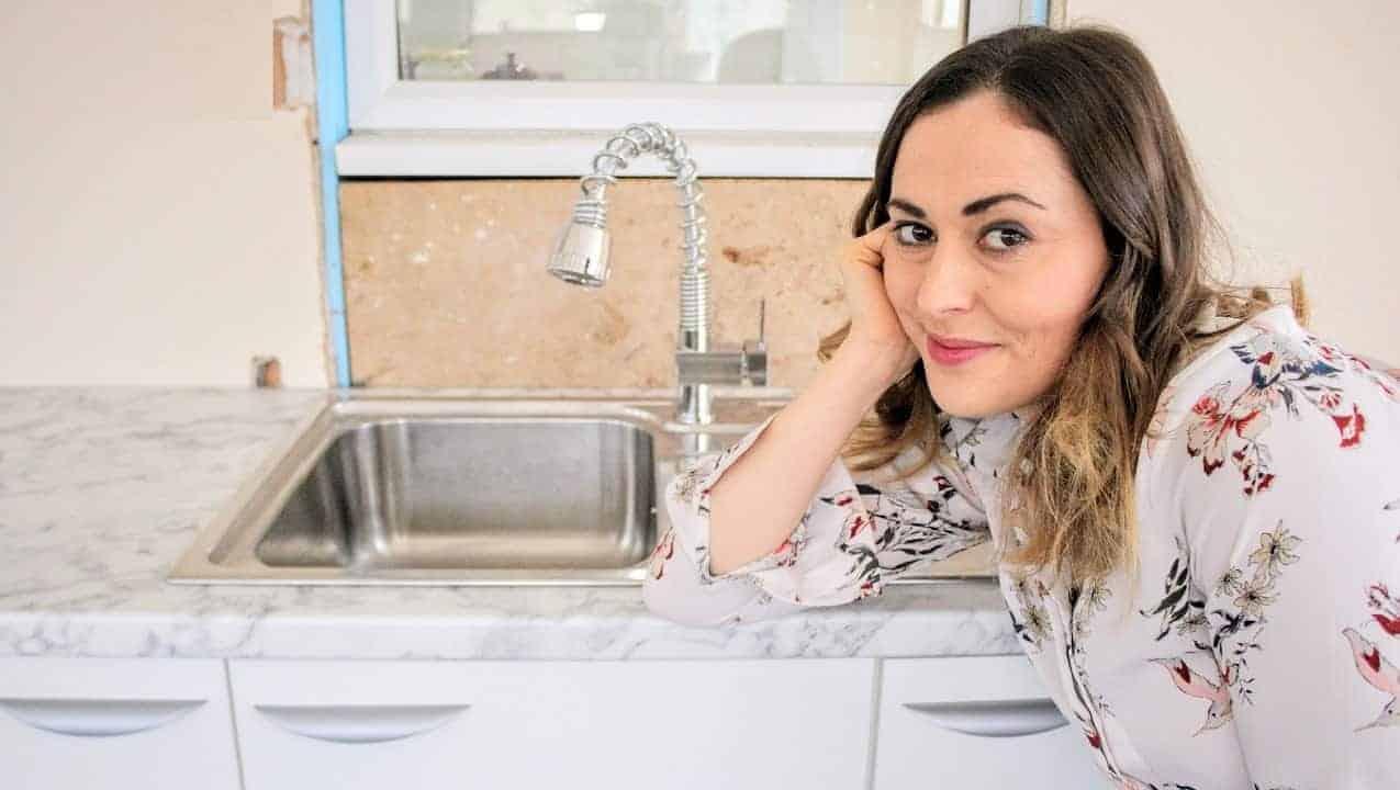 a kitchen sink in a laminate worktop