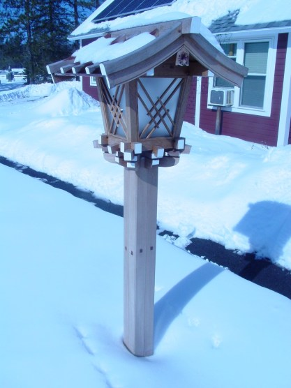 Shrine lantern with snow on the roof
