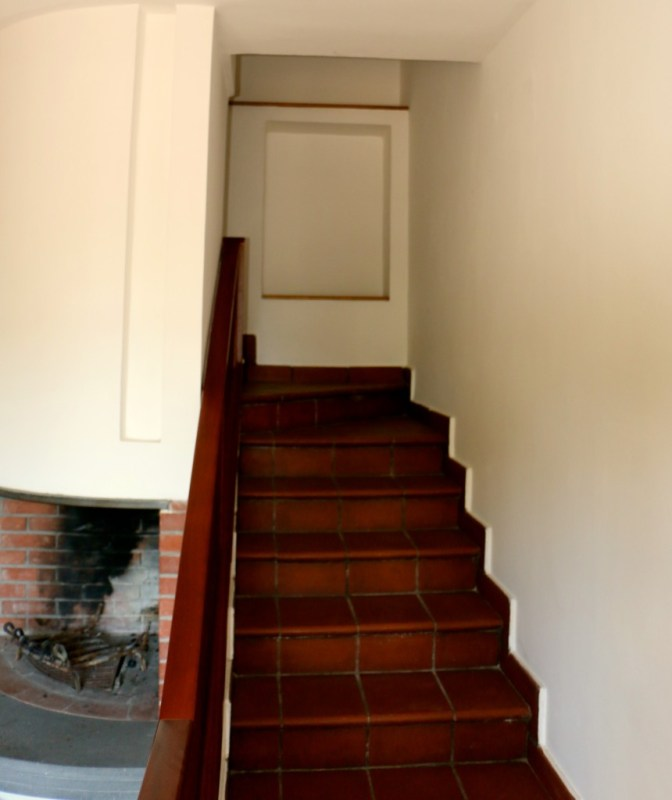 Fireplace next to the Staircase