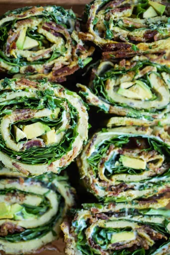 egg roll-ups with bacon, greens, and avocado