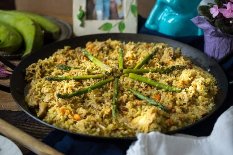rice with chicken and asparagus in a skillet