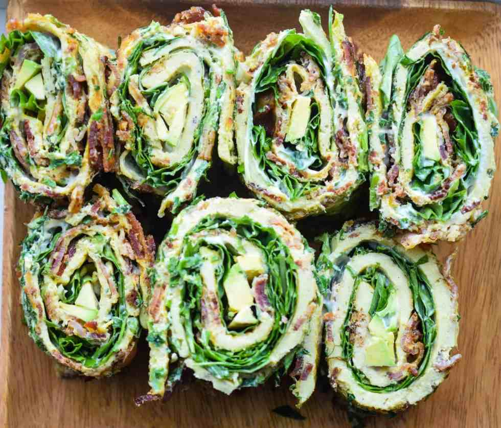 eggs rolled up with bacon and greens