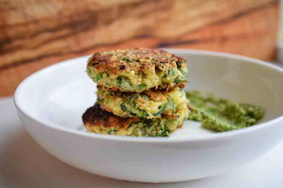 zucchini fritters stacked in white bowl