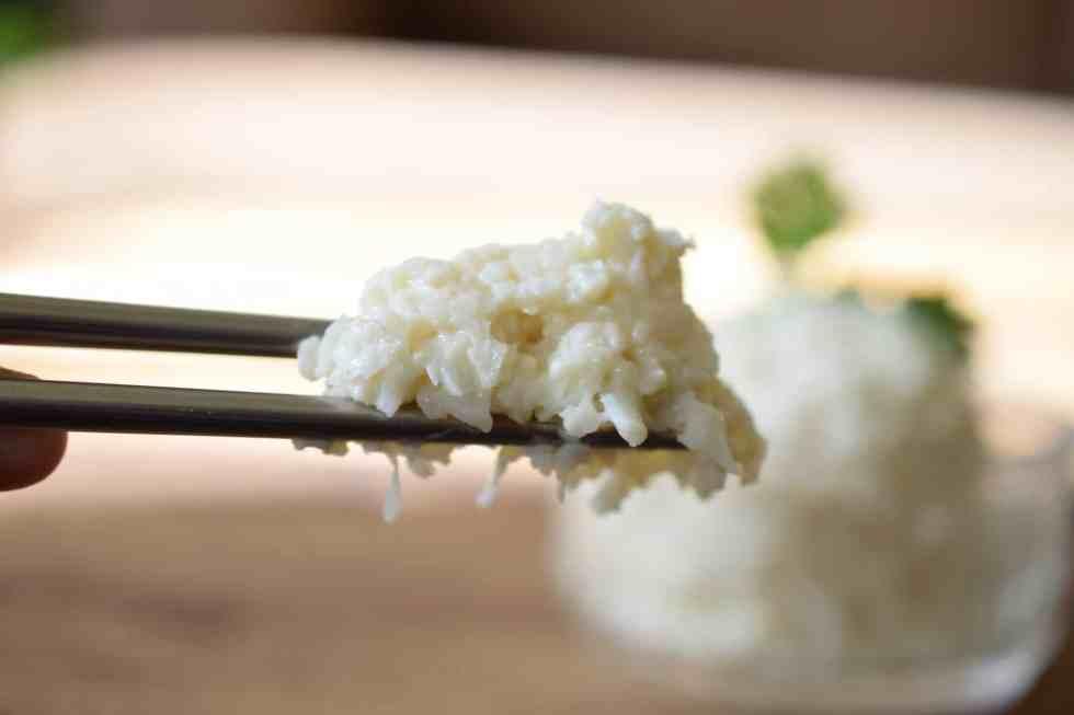 chopsticks holding paleo sushi rice