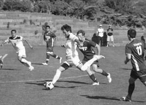 Matthew Fechter beats a defender to the ball. Photo courtesy of Daniel Wright