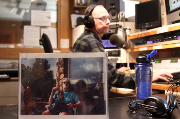 Mike Procell, KRCC operations manager, broadcasts on air Thursday, Nov. 15 next to a picture of Jocelyn Sandberg who was killed on April 26, 2002. Photo by Sam Zarky.