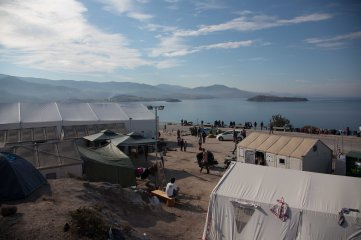 Morning at Camp OXY, a transition camp where people are fed clothed and put on bus's to processing camps near the main port.
