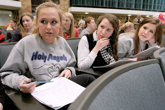 From left, Academy of Holy Angels seniors Annah Blackburn, left, Anne St. Amant and Alyssa Radosevich discuss what they heard during a mock trial Jan. 31 at the University of St. Thomas in St. Paul, in which arguments were made for and against the Roe v.?Wade U.S. Supreme Court decision that legalized abortion in America. Dave Hrbacek / The Catholic Spirit