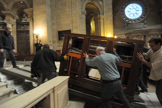 One of the two new organ consoles is moved into the Cathedral sanctuary Feb. 28