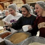 Let's get packing:  St. Patrick hosts food prep event for Feed My Starving Children