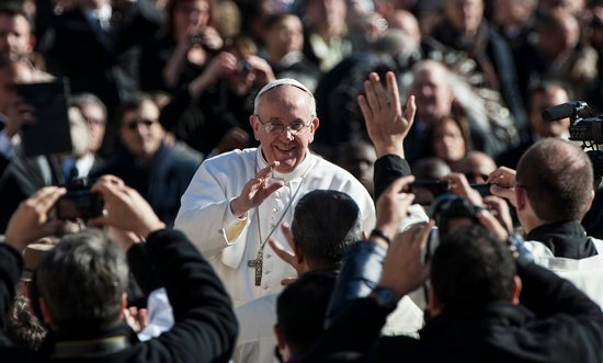 Pope Francis greets people in St. Peter's Square before celebrating his inaugural Mass at the Vatican March 19. CNS photo/Alessia Giuliani, Catholic Press Photo