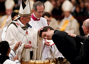 Pope Francis baptizes a young man during the Easter Vigil in St. Peter's Basilica at the Vatican March 30. (CNS photo/Paul Haring)