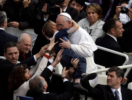 This photo by AP photographer Gregorio Borgia of Pope Francis embracing 8-year-old Dominic Gondreau, who has cerebral palsy, captured the attention of people around the world. Gregorio Borgia, AP via CNS