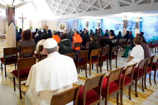 "Pope Francis sits with Vatican workers after celebrating Mass March 22 inside the chapel of the Domus Sanctae Marthae, the Vatican residence where the new pontiff resides. The pope took a seat in the back row as people lingered for private prayer. ""Humility is an important virtue for any leader — the bigger the organization, the more important it is,"" writes Tom Bengtson. CNS photo / 'Osservatore Romano"