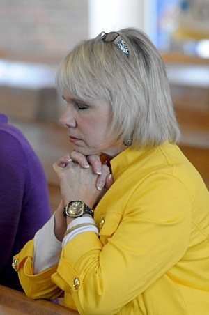 Sharon Balk, a member of St. Paul in Ham Lake prays during the Mass with Archbishop Nienstedt.