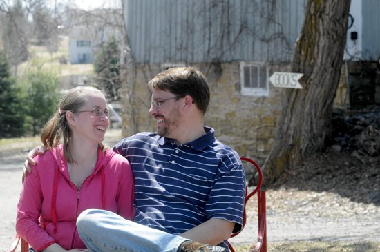 Christopher Hagen and his wife Christelle relax on Claret Farm outside of Stillwater April 27. The farm also is home to Loome Theological Booksellers, which Hagen relocated from its previous location in Stillwater. Dianne Towalski / The Catholic Spirit