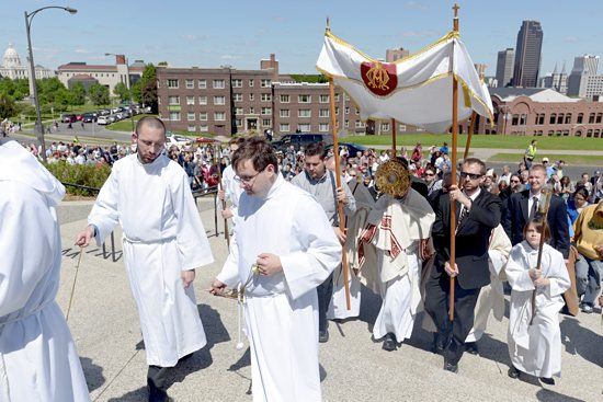Participants in the 17th annual Archdiocesan Corpus Christi Procession walk behind the Blessed Sacrament into the Cathedral of St. Paul June 2, the feast of The Most Holy Body and Blood of Christ (Corpus Christi). The procession, led by Bishop Lee Piché, began at the Little Sisters of the Poor Holy Family Residence on Exchange Street in St. Paul and ended with a Year of Faith holy hour at the Cathedral. The event coincided with a Vatican request that Catholics gather in churches on that day for a worldwide hour of eucharistic adoration. Jim Bovin / For The Catholic Spirit