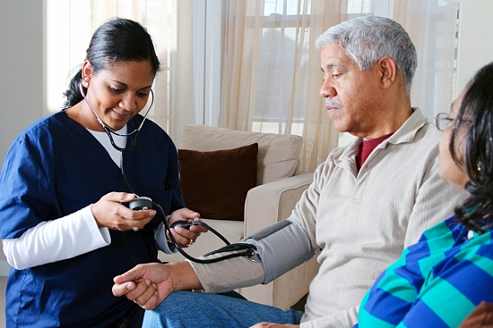 A home health care worker checks a man's blood pressure. Home care allows individuals and their families to choose the services they need and tailor them to fit their lifestyle. Bigstockphoto.com