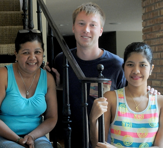 Greicys Ramos-Rivas, right, and her mom Gregoria, left, are staying with Cameron Perra, center, while Greicys recouperates from her spinal surgery. Dianne Towalski / The Catholic Spirit