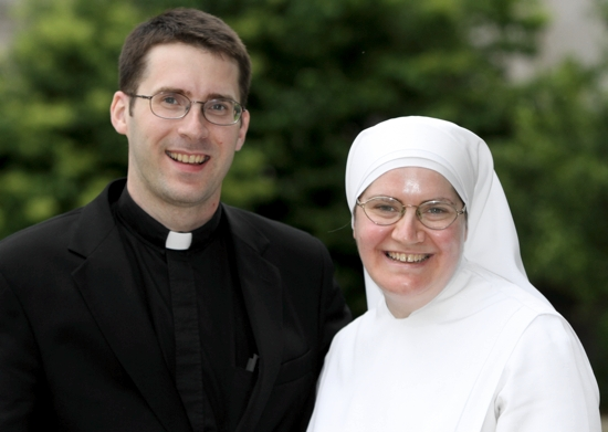 Father John Paul Erickson, left, enjoys a visit with his sister, Sister Maria Grace Erickson, who joined the Little Sisters of the Poor in 1995. She is able to come home for a visit once every three years, and her most recent visit was last month. Dave Hrbacek / The Catholic Spirit