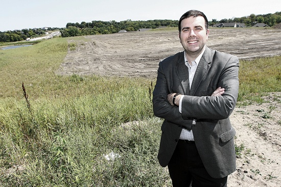 Jason Slattery, president of Ave Maria Academy, stands on the site in Maple Grove where the new school building will be constructed. The groundbreaking took place Aug. 15. Dave Hrbacek / The Catholic Spirit