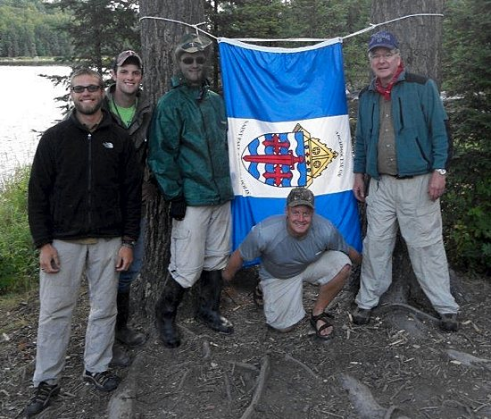 Archbishop John Nienstedt, right, stands in the Boundary Waters with seminarians, from left, Aric Aamodt, Colin Jones, Matthew Bearth and Corey Manning of St. John Vianney College Seminary in St. Paul. Photo courtesy of Archbishop Nienstedt