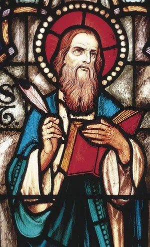 St. Matthew is depicted in a stained-glass window. As author of the first Gospel, Matthew is often depicted with a tablet. His feast day is Sept. 21.  CNS photo/Crosiers