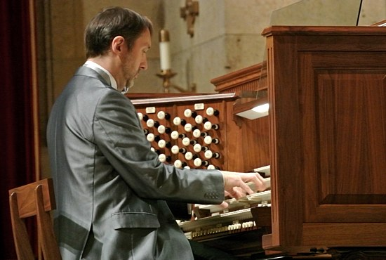 The Cathedral of St. Paul was filled to capacity with people standing in every available space for the inaugural concert of the Cathedral's newly restored 1927 E.M. Skinner and 1963 Æolian-Skinner organs Oct. 24. Above, internationally acclaimed organist Olivier Latry of the Cathedral of Notre-Dame in Paris plays both historic pipe organs from the console that normally sits in the sanctuary behind the main altar. An identical console is located in the choir gallery. Both organs can be played from either console.  Dianne Towalski/The Catholic Spirit