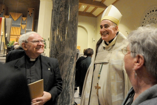 Bishop Donald Kettler visits with Father Gerald Mischke after a vespers service Nov. 6 at St. Mary's Cathedral in St. Cloud. Bishop Kettler was installed as the ninth bishop of the Diocese of St. Cloud on Nov. 7. Dianne Towalski / The Catholic Spirit