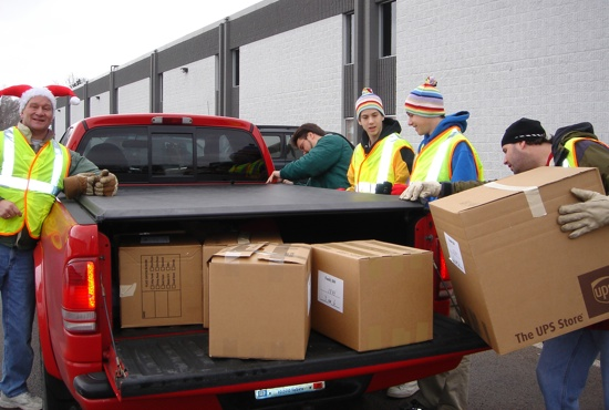 Sponsor A Family uses nearly 300 warehouse volunteers every December to receive, process and distribute donations. Many volunteers like Mark Scheidhauer, left, and Patton Hafforth, right, return each year to share the joy of Christmas with those in need.  Photo submitted